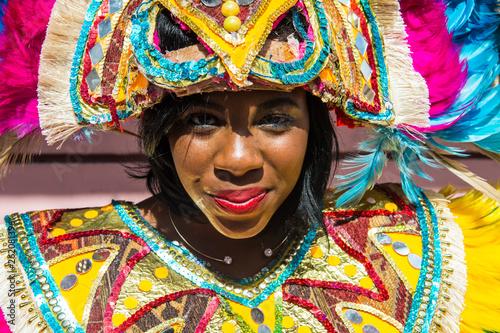 Bahamas, Nassau, Woman posing in a colorful carneval costum