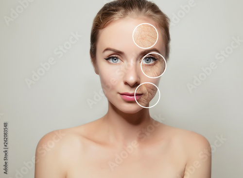 Obraz woman face divided in two halves with young and old skin - fototapety do salonu