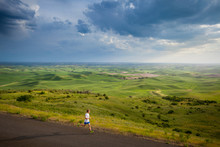 Distance Runner Ian Engerbretson On A Late Afternoon Run On The Scenic Windy Road Up Steptoe Butte State Park In Eastern Washington State In Peak Spring Conditions.