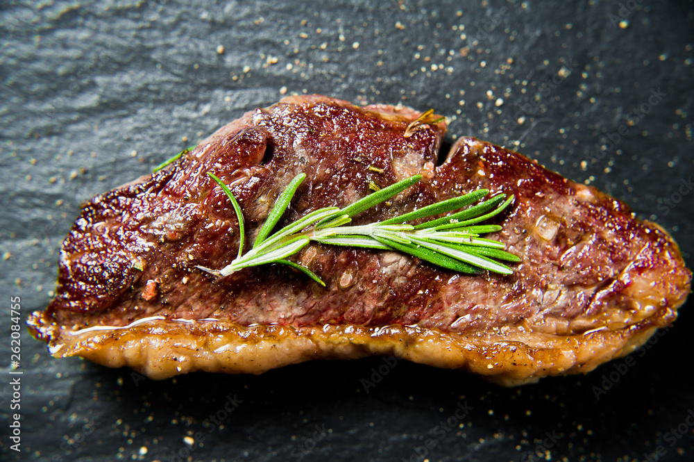 Fototapety, obrazy: Steak of marbled beef black Angus roast rear. Black background, top view.