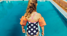 Girl Learning Spring Board Diving At Pool