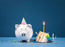Slice Of Birthday Cake With Piggy Bank