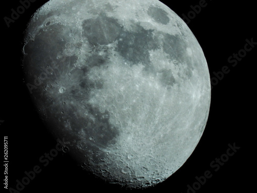 a close-up of a three-quarter moon in the night sky Wallpaper Mural