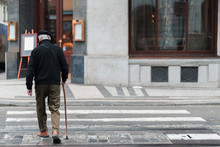 An Elderly Male With A Walking...