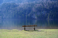 Wooden Bench At A Mountain Lake In The Morning Light, Copy Space