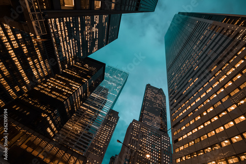 night view of Toronto city skyscrapers; look up;