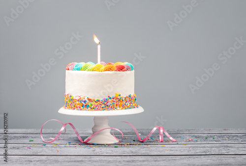 White Birthday Cake with one Candle and Colorful Icing Canvas Print