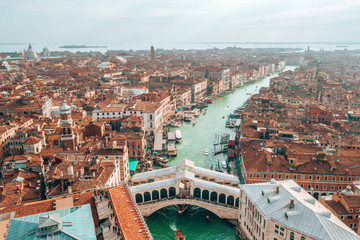 Aerial panoramic view of famous Canal Grande and famous Rialto Bridge at suns...