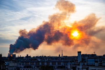 Notre Dame burning during sunset, Paris
