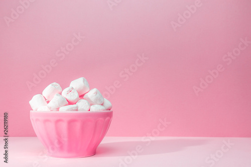 Fotografie, Obraz  Pink bowl of giant marshmallows on pink backdrop with harsh shadows