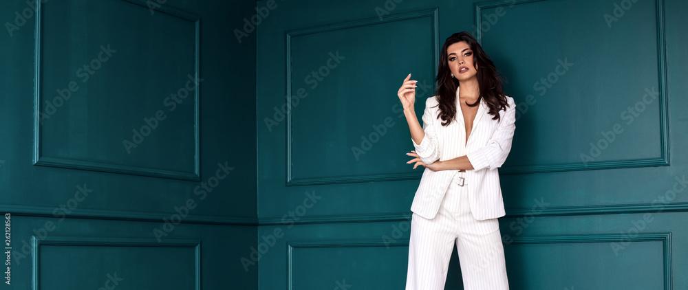 Fototapeta Beauty Fashion brunette model girl wearing stylish suit.