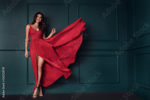 Fashion lady in red maxi dress. Fototapet