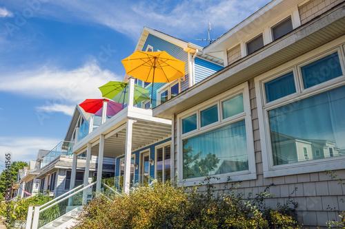 Fototapeta Beach houses with colorful umbrellas