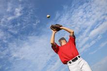 Boy Catching A Baseball