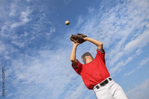 Boy catching a baseball Canvas Print