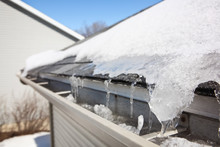 Ice On Roof And Gutters Causin...