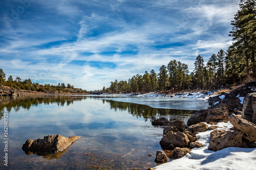 A quiet wintry scene along the shore of Fools Hollow Lake Fototapeta