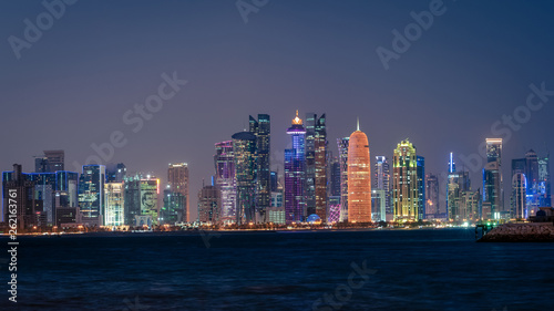 Photo Stands Shanghai Doha Qatar skyline cityscape with skyscrapers at night
