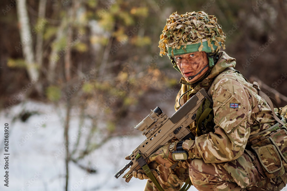 Fototapety, obrazy: British special forces soldier with weapon take part in military maneuver. war, army, technology and people concept.