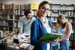 Leinwandbild Motiv Happy young university students friends studying with books at university