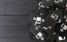 Blank Floppy Disks On Wood Bac...