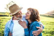canvas print picture Senior couple hugging outside in spring nature.