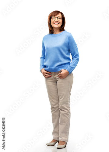 vision and old people concept - smiling senior woman in glasses over white background Wall mural