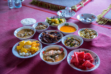 Tradition Northern Thai Food. On A Wooden Table, Set Of Thai Food Popular Menu. Radition Lunch Or Dinner.Thai Food Concept Spicy Paste Dip Nam Prik Asian Style Banquet.Thai Traditional Kantoke Set.