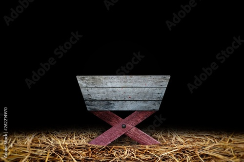 Old Wooden Manger in Dark Barn with Hay be Covered on Ground. Canvas Print