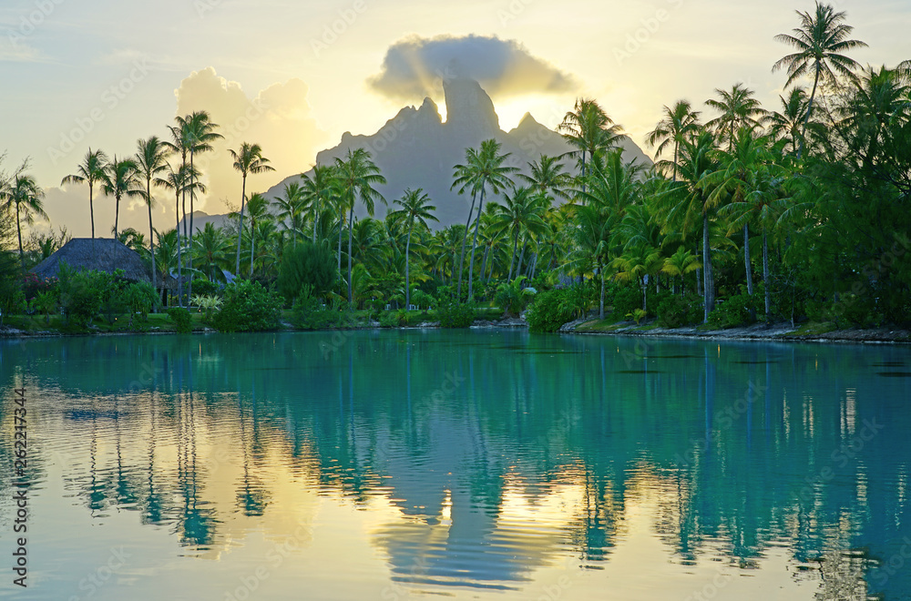 Fototapeta View of the Mont Otemanu mountain reflecting in water at sunset in Bora Bora, French Polynesia, South Pacific