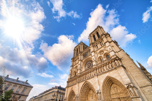 Fotografie, Obraz Notre Dame majestic facade against a beautiful blue sky