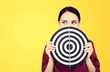 canvas print picture - Beautiful businesswoman portrait holding round target of darts
