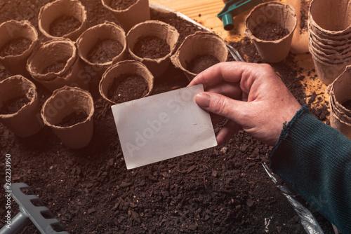 Fototapeta Gardener holding blank business card mock up
