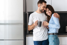 Beautiful Young Couple Drinking Coffee