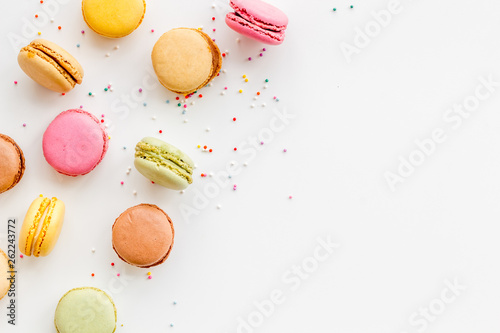 Macarons Brignt macarons for sweet break on white background top view mock up