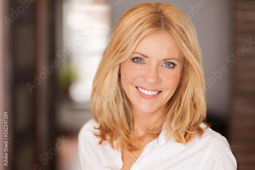 Fotografie, Obraz Mature woman smiling at the camera