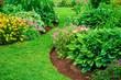 Leinwanddruck Bild - Perennial flower beds with lilies, hosta and bleeding hearts.