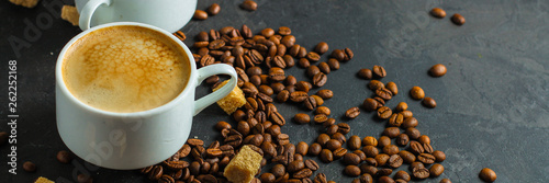 coffee fresh and hot in a white cup, aroma. serving of beverage (coffee grain). food. top view. copy space