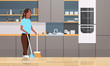 housewife sweeping floor with broom and scoop african american girl doing housework house cleaning concept modern kitchen interior female character full length horizontal