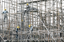 Construction Workers On Scaffo...
