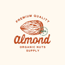 Premium Quality Almond Abstract Vector Sign, Symbol Or Logo Template. Hand Drawn Almond Nut Sketch Sillhouette With Retro Typography And Seal. Vintage Luxury Emblem.