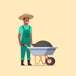 gardener man pushing wheelbarrow full of earth compost african american male farmer working in garden wearing overalls gardening concept full length