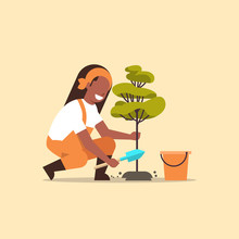 Female Farmer Planting Young Tree African American Gardener Woman Digging Soil Working In Garden Agricultural Gardening Concept Flat Full Length