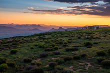 Sunset Landscape Over Small Village With Mountains, Clouds And Orange Sky, Lesotho, Africa