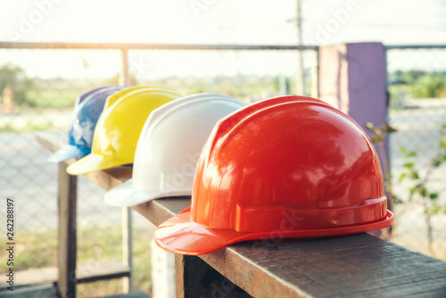 Fotografia  Safety helmet (hard hat) for engineer,safety and health officer or architect,place on old wooden floor