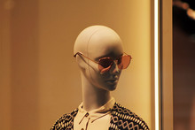 Bust Of A Mannequin On A Beige Background, Feminine Dummy In Sunglasses