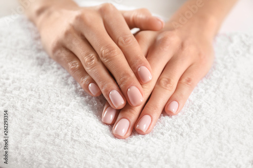 Printed kitchen splashbacks Manicure Closeup view of beautiful female hands on towel. Spa treatment