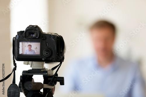 Shooting video or making photo using camera on tripod