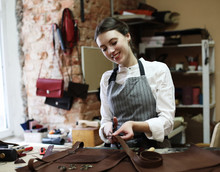 Woman Works In A Bag Making Studio, Cuts Out Details