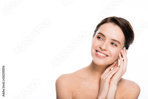 Fototapeta happy nude woman smiling while touching skin isolated on white obraz na płótnie